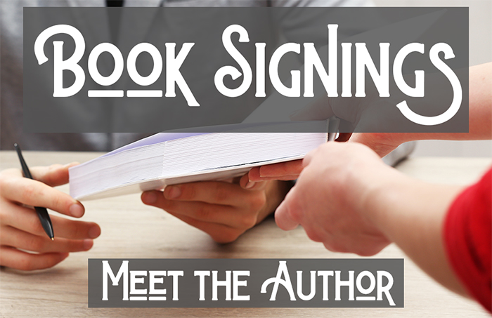 one person presents a book to be signed to the author, who holds a pen